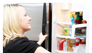 Woman at refrigerator